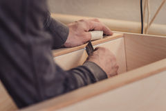 Man builds furniture in the carpentry shop. Royalty Free Stock Photo