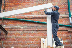 Man builds a house of a wooden beam royalty free stock image