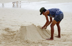 A man builds the sand castle on the beach in Boracay, Philippines Royalty Free Stock Photo