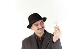 Man with a bulb Royalty Free Stock Photo
