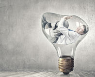 Man in bulb Royalty Free Stock Photography