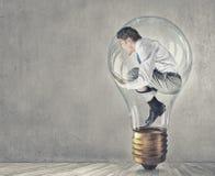 Man in bulb Stock Image