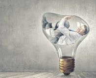 Man in bulb Stock Photos