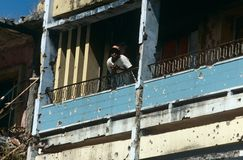 A man in a bullet riddled building in Angola Stock Photo