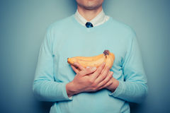 Man with a bunch of bananas Stock Images