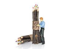Man with bunch of colored pencils Stock Photography