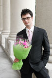 Man with a bunch of flowers. Stock Image