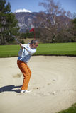 Man at the bunker on a golf course Royalty Free Stock Photography