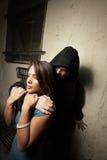Man burglarizing a woman Royalty Free Stock Photo