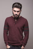 Man in burgundy sweater holding his hands in pocket Royalty Free Stock Photography