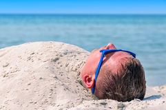 Man buried in the sand Royalty Free Stock Image