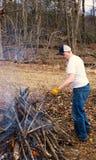 Man buring brush Royalty Free Stock Photography