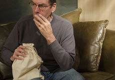 Man with burlap bag Stock Photography