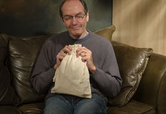 Man with burlap bag Royalty Free Stock Photo