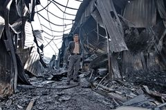 Man in burned building. A man standing in the middle of a building destroyed by fire Royalty Free Stock Images