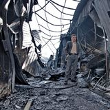 Man in burned building Stock Images