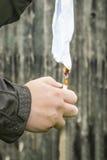 Man burned paper Stock Image