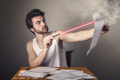 Man burning bill with laser Royalty Free Stock Photo