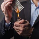 Man burning cash Stock Images