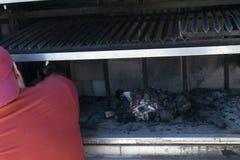 Man burning coal Royalty Free Stock Photos