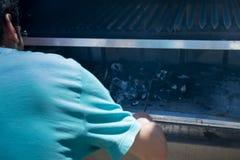 Man burning coal Stock Photography