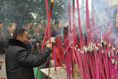 A man burning incense upon the incense altar Stock Images