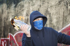 Man with a burning Molotov cocktail Stock Photography
