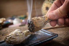 Man burning white sage incense. Man`s hand with burning natural white sage incense Stock Images