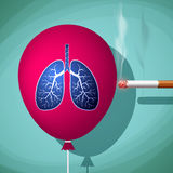 Man bursts cigarette red balloon with human lungs.  Stock Images