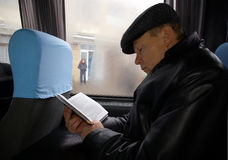 Man in the bus. The man in the bus reads the book Stock Photos