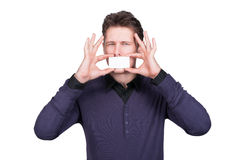 Man with business card. In mouth Royalty Free Stock Images