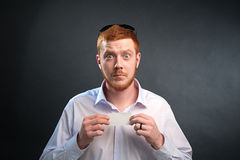 Man with a business card in the hands of Stock Photos