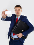 Man with a business card Royalty Free Stock Images