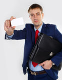 Man with a business card Royalty Free Stock Image