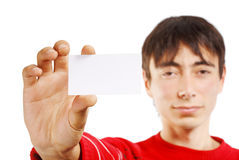 Man with business card. Portrait of man in red sweater isolated on white background holding little business card Stock Photos