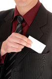 Man with business card. Royalty Free Stock Images