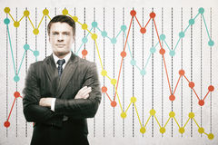 Man on business chart background Stock Images