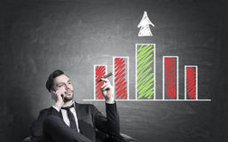 Man with business chart Stock Images