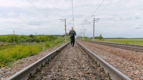 A man in business clothes with a laptop running on rails. Glad that the problem is solved. stock footage
