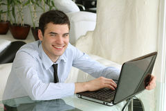 Man of business. Handsome boy with laptop. Man of business. Handsome young boy with laptop in interior Stock Photo
