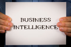 Man with Business Intelligence sign Stock Photo