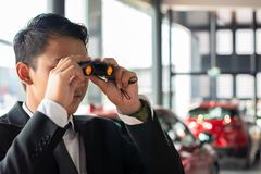 Man business looking binoculars. On blurred background royalty free stock photos