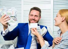 Man business owner sit office pile of money. Bank assistant offer plastic card. Create bank account. Credit loan and. Cash concept. Businessman with cash bank stock image