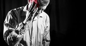 Man in business shirt suffered from head pain Stock Photos