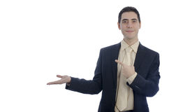 Man in business showing something with his right hand. Royalty Free Stock Image