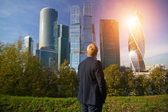 Man in a business suit. On a background of business center Stock Photos