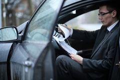 Man in a business suit in the car royalty free stock photo