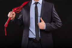 Man in business suit with chained hands. handcuffs Stock Image