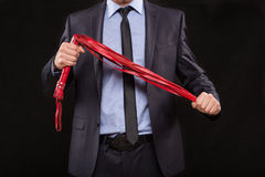 Man in business suit with chained hands. handcuffs Royalty Free Stock Image