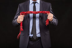 Man in business suit with chained hands. handcuffs Royalty Free Stock Images